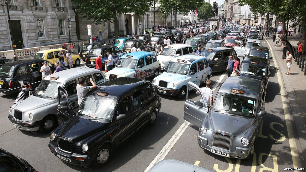 Taxi drivers protest against cab-sharing firm Uber in London