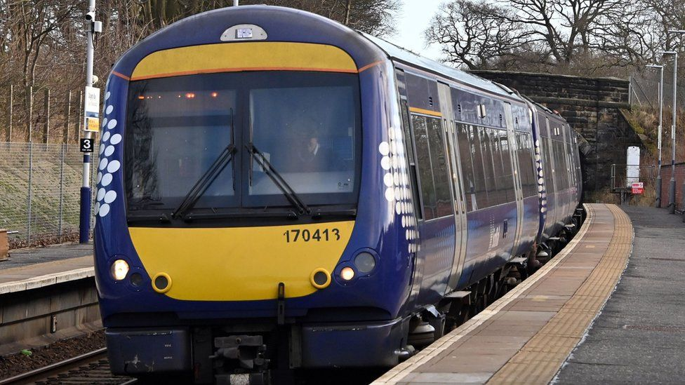 A ScotRail train pulls into a station in Fife