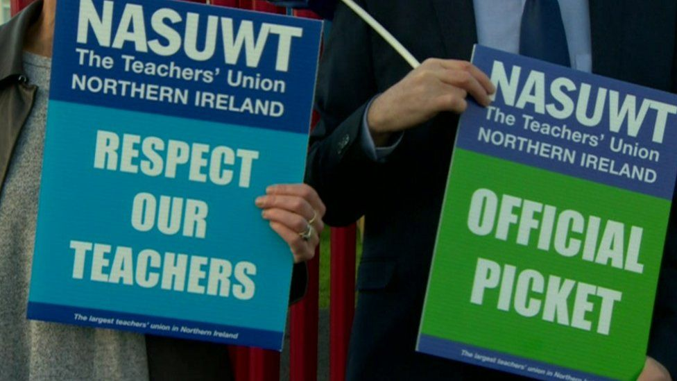 Striking teachers hold placards outside St Patrick's School in 2018.