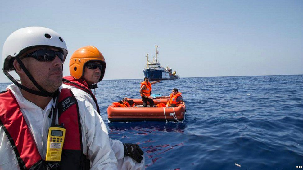 An image published online by Medecins sans Frontieres of rescuers and rescued migrants - 5 August 2015