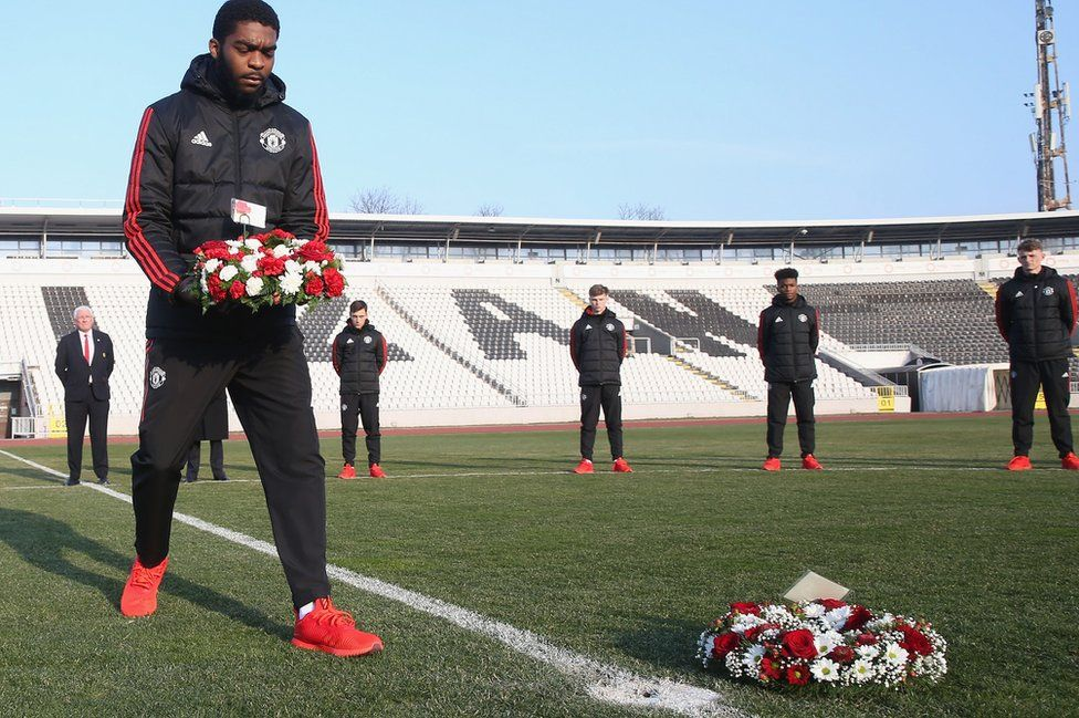 Ro-Shaun Williams of Manchester United U19s lays a wreath at Partizan Stadium