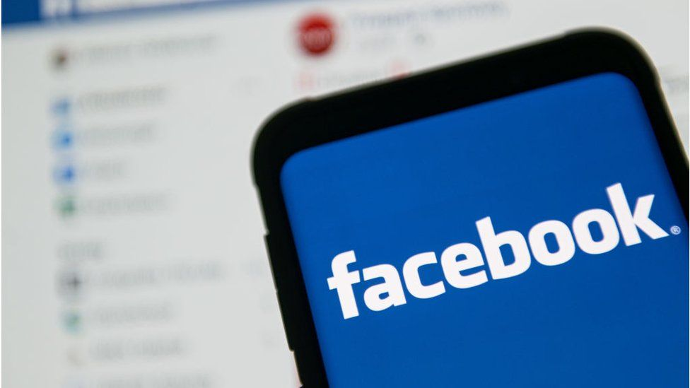 The Facebook logo on a smartphone.