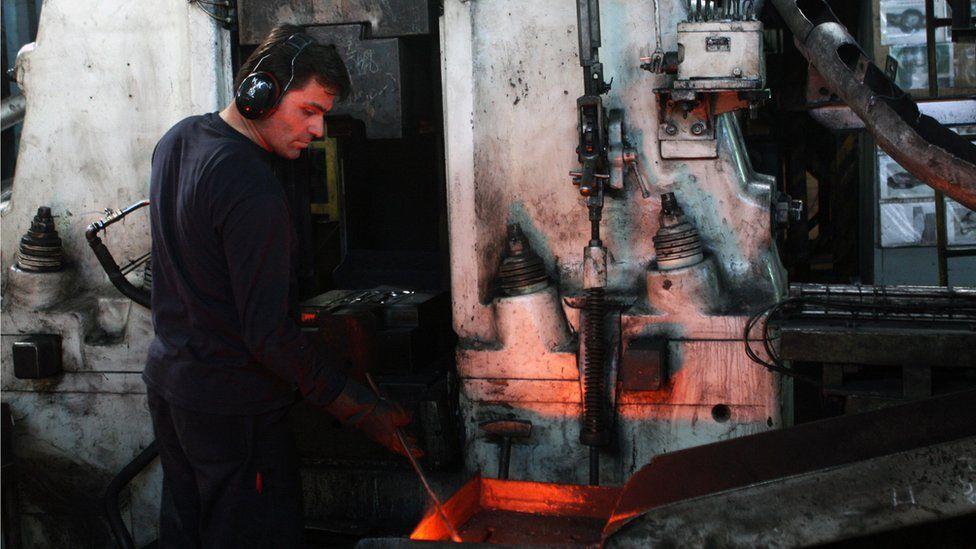 Employee working in a car spare parts factory in Gebze, Turkey (November 2008)