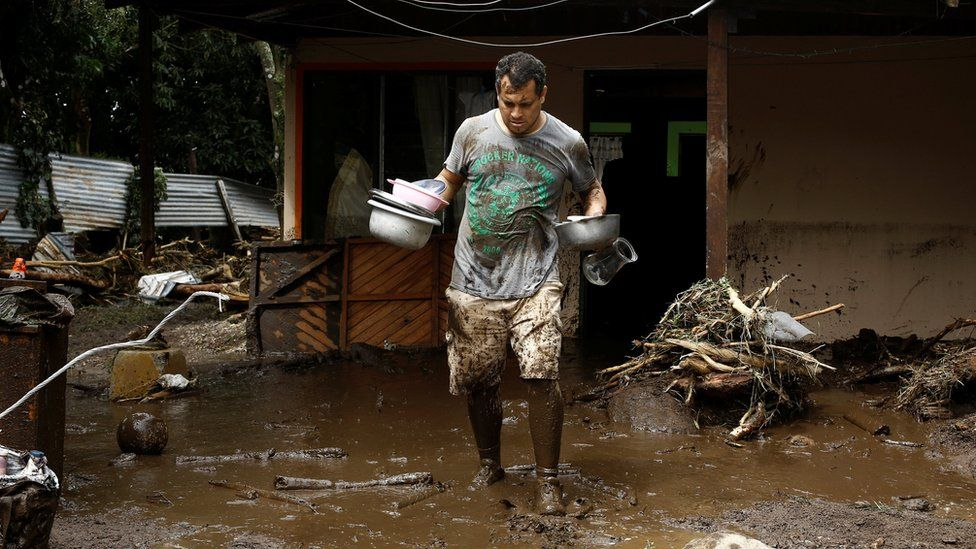 A man removes belongings from his home damaged after hurricane Otto hit in Guayabo de Bagaces, Costa Rica