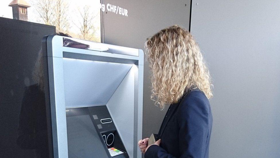 Customer in Switzerland uses new ATM