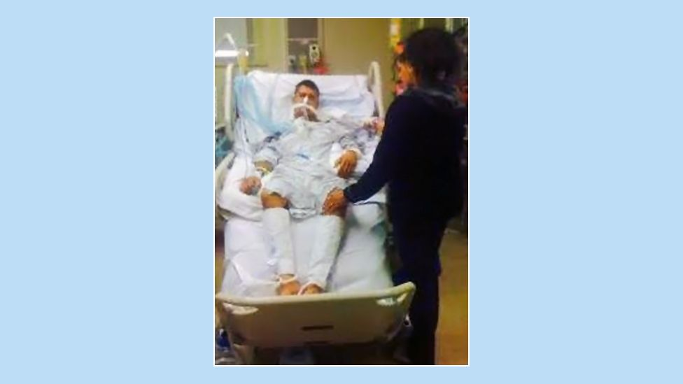 Adam in hospital after his attack in 2011