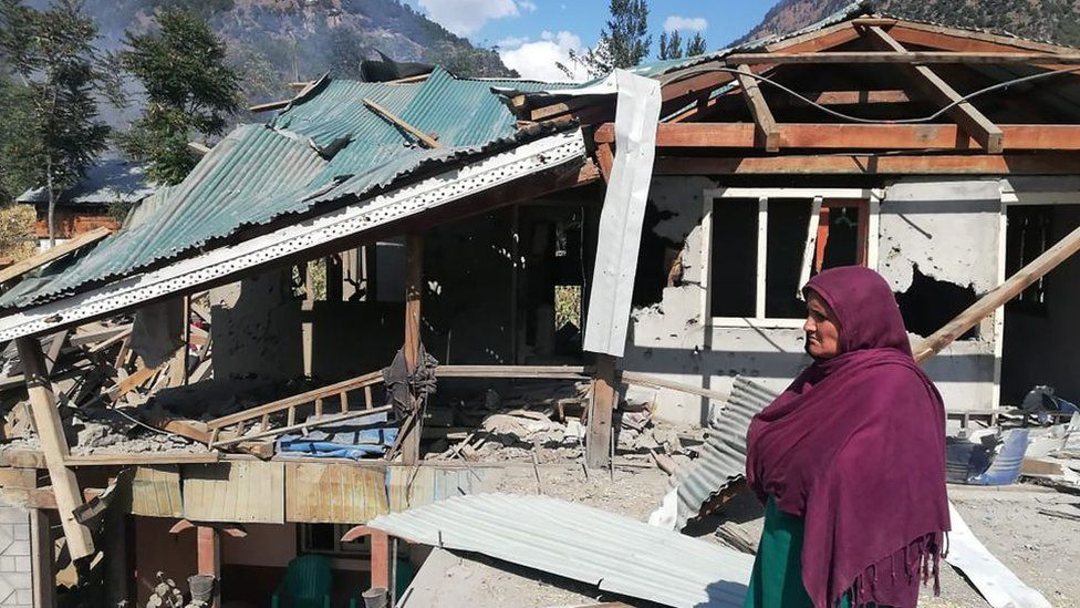 A resident stands in front of her damage house a day after cross border shelling in Jora, a village of Neelumvalley in Pakistan-administered Kashmir on October 20, 2019. - At least nine people were killed on October 20 in firing along the de facto India-Pakistan border in Kashmir