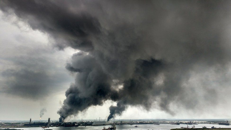 View of smoke following an explosion at the petrochemistry installation of Mexican Oil Company PEMEX in Coatzacoalcos, Veracruz state, Mexico on April 20, 2016