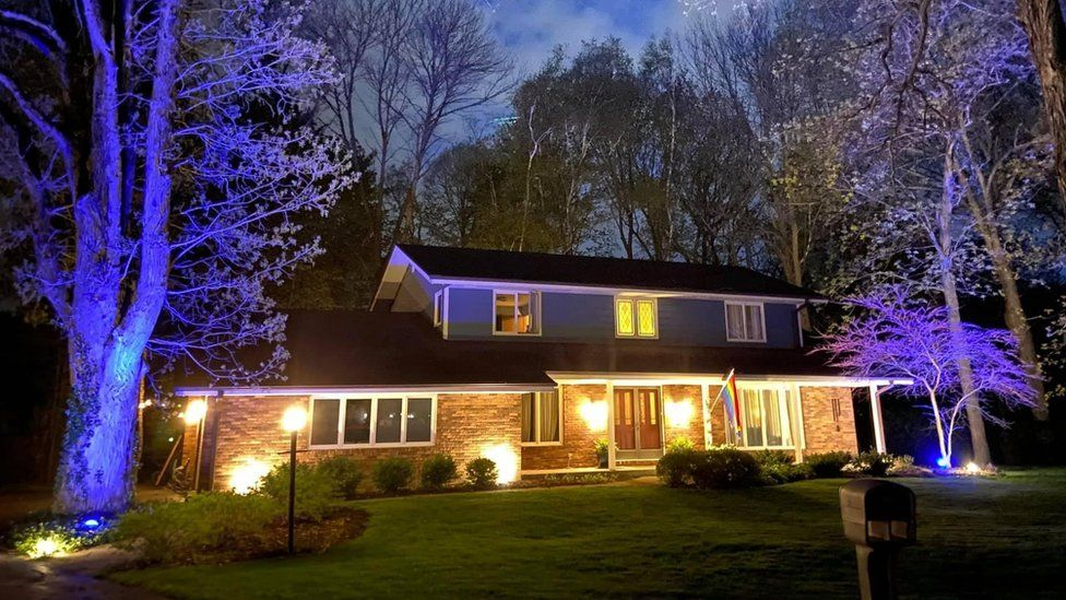 How the couple's house looked before the floodlights were changed