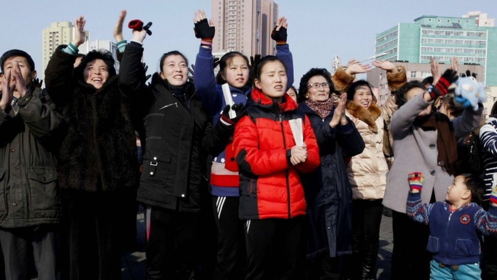 Crowds in Pyongyang clap and cheer as state media claims the country has tested an H-Bomb