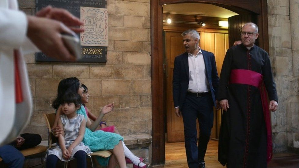 Sadiq Khan arrives with the Dean of Southwark Cathedral The Very Reverend Andrew Nunn