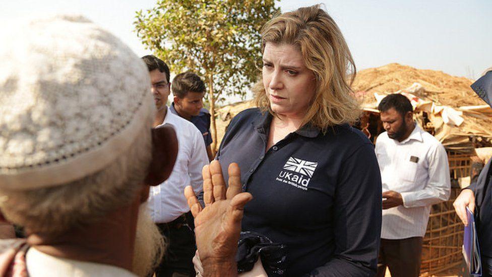 Penny Mordaunt talks to a Rohingya refugee in Kutapalong, near Cox's Bazar,