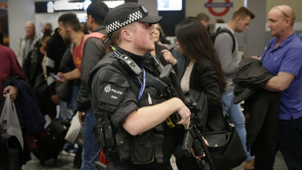 Armed policeman on the Tube network in London