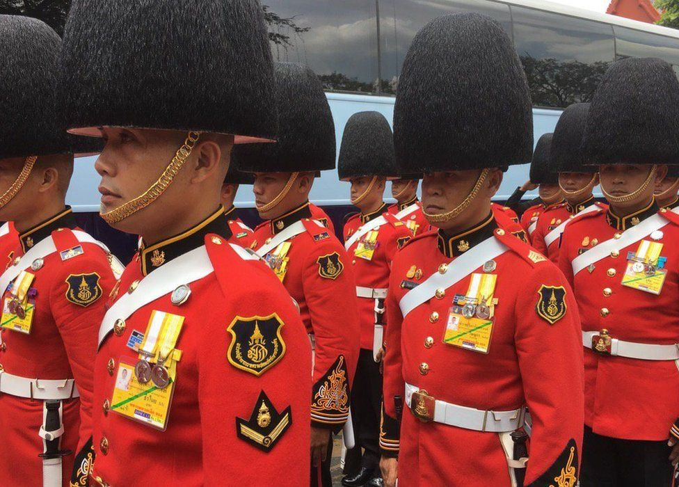Soldiers dressed in ceremonial outfits gathering outside the Grand Palace in Bangkok on 14 October 2016