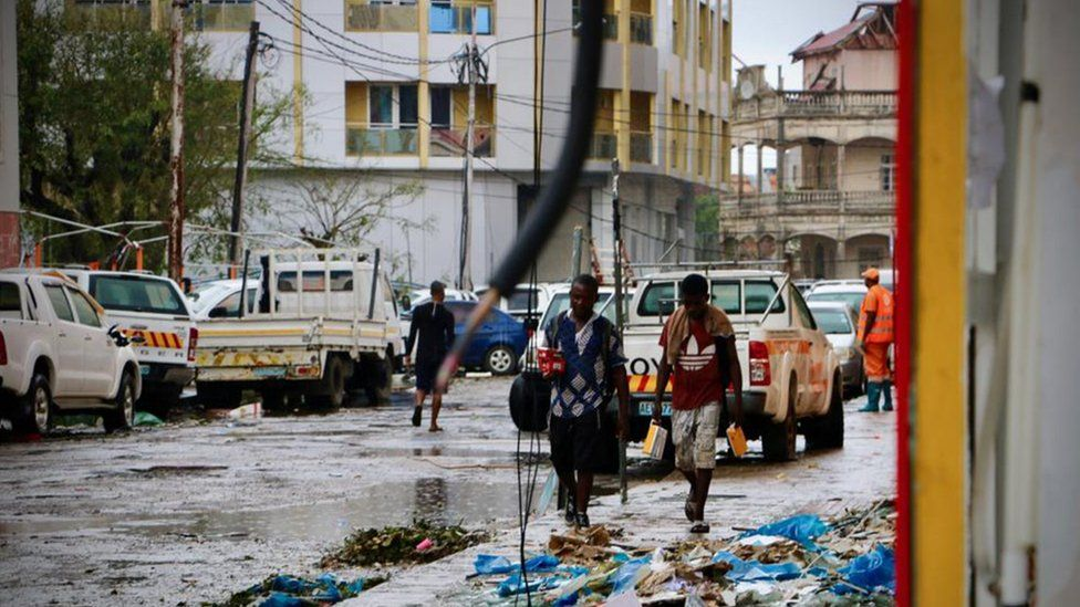 People walk through the ravaged pavements of Beira, Mozambique