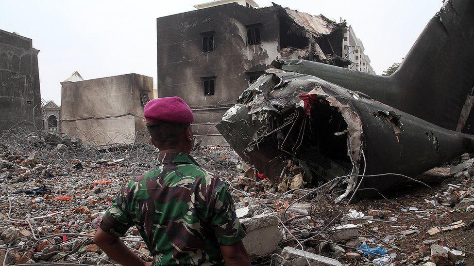 Debris of C-130 Hercules on houses in Medan, Indonesia (1 July 2015)