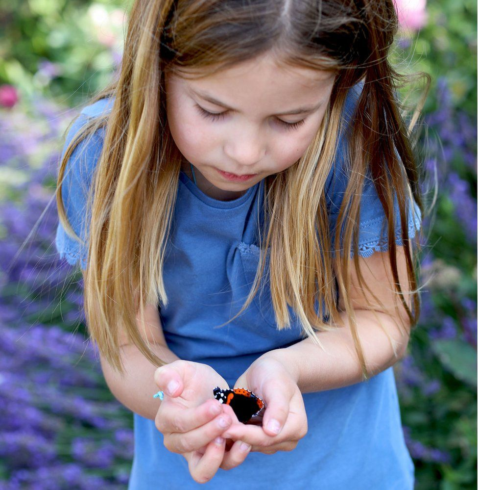 Princess Charlotte holding a butterfly