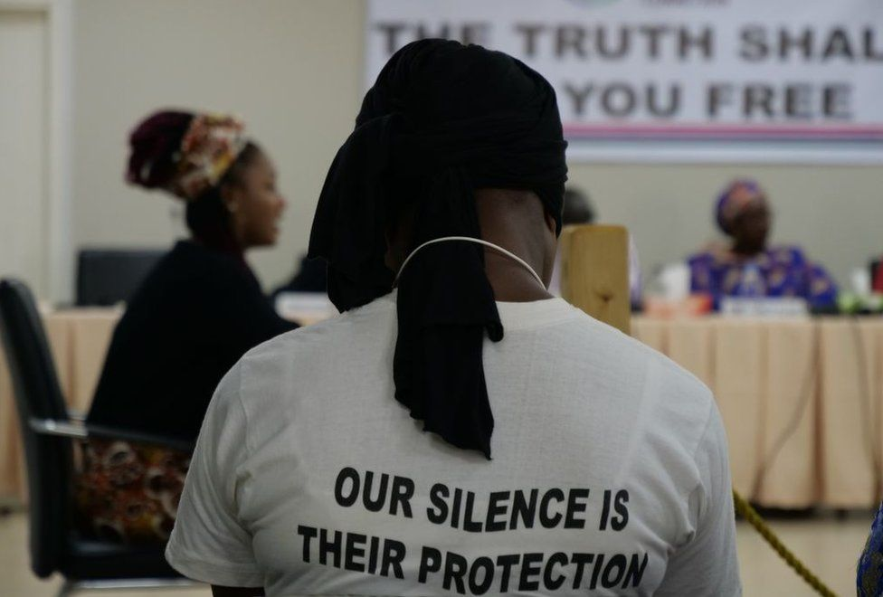 A #IamToufah campaign supporter, listening to former Gambian beauty queen, Fatou Jallow, testifying before the country's Truth and Reconciliation Commission in Banjul on October 31, 2019
