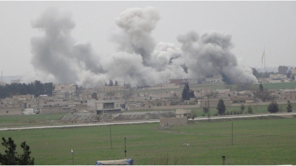 Smoke rises over the northern Syrian town of Tal Abyad as it is pictured from the Turkish border town of Akcakale, in Sanliurfa province.