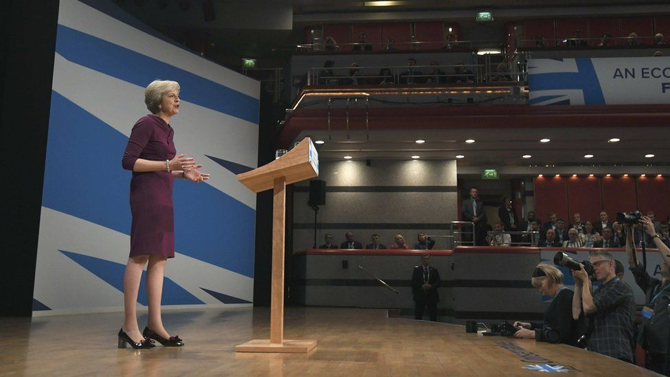 Theresa May gives her speech on the final day of the annual Conservative Party Conference in Birmingham