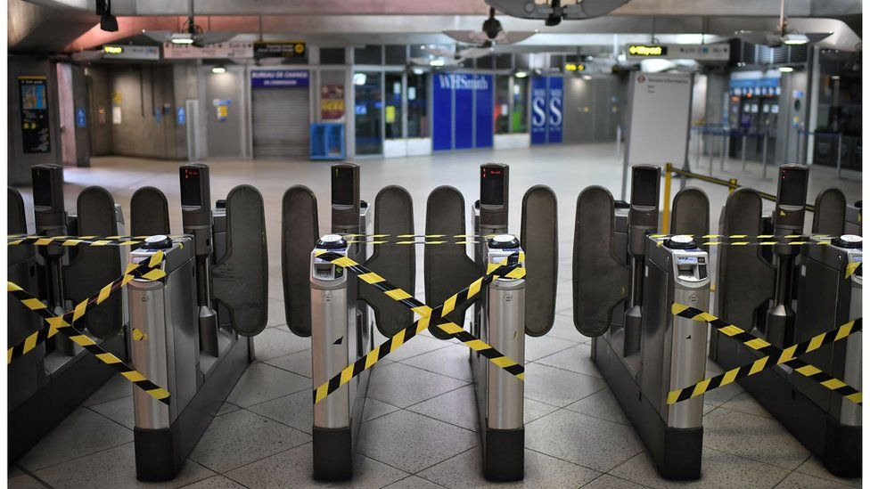 Alternate ticket turnstiles are cordoned off to make commuters observe social distancing measures as a precautionary measure against COVID-19, at Westminster underground station