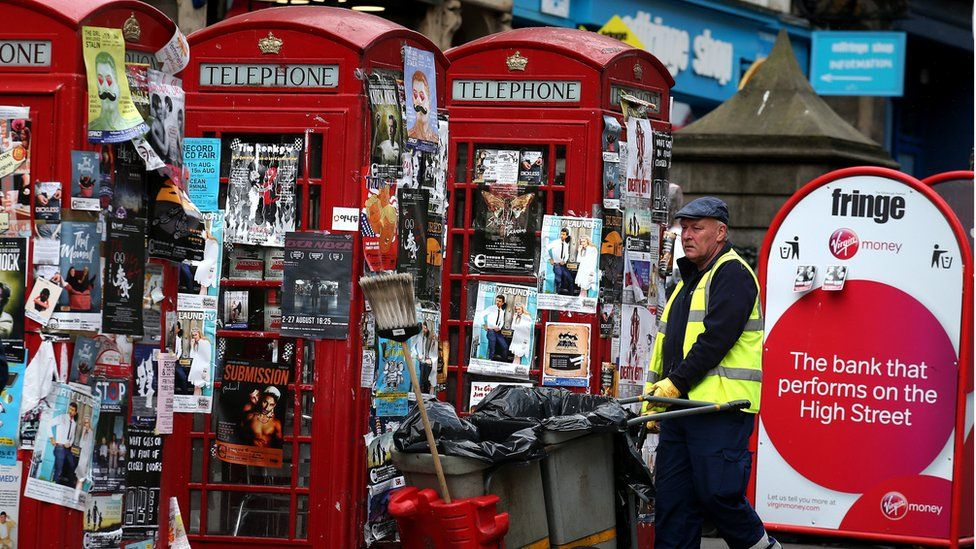Phone boxes covered in posters