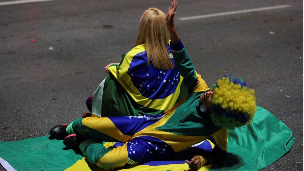 Supporters of Jair Bolsonaro, far-right lawmaker and presidential candidate of the Social Liberal Party (PSL), react after Bolsonaro wins the presidential race, in Sao Paulo, Brazil O