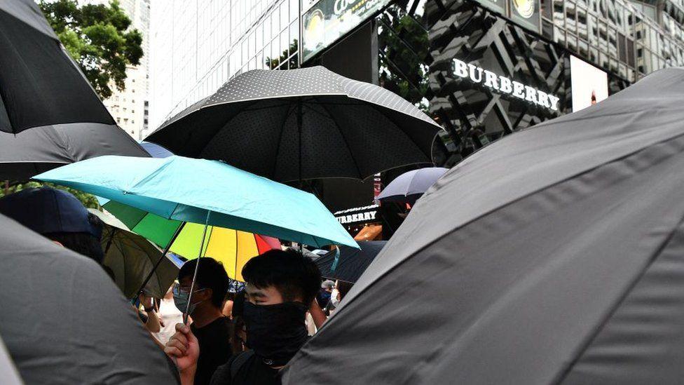 Hong Kong protestors outside a Burberry store
