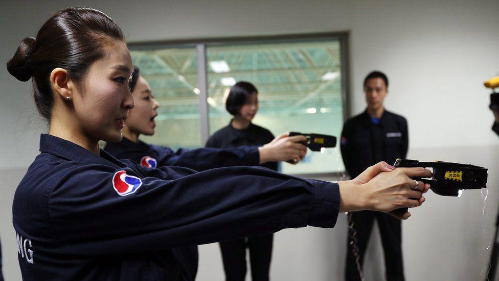 Korean Air crew practice using electric stun guns