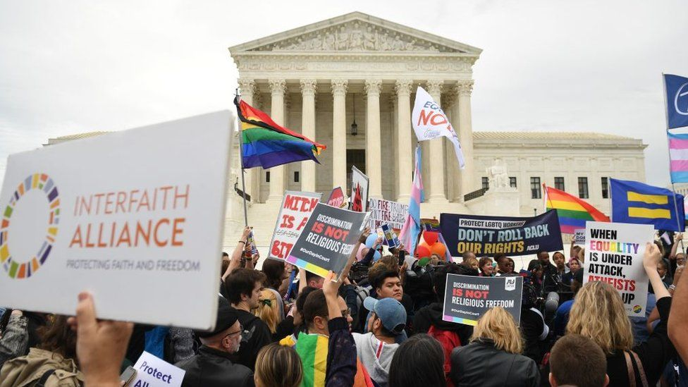 Demonstrators in favour of LGBT rights rally outside the US Supreme Court in Washington, DC, 8 October, 2019