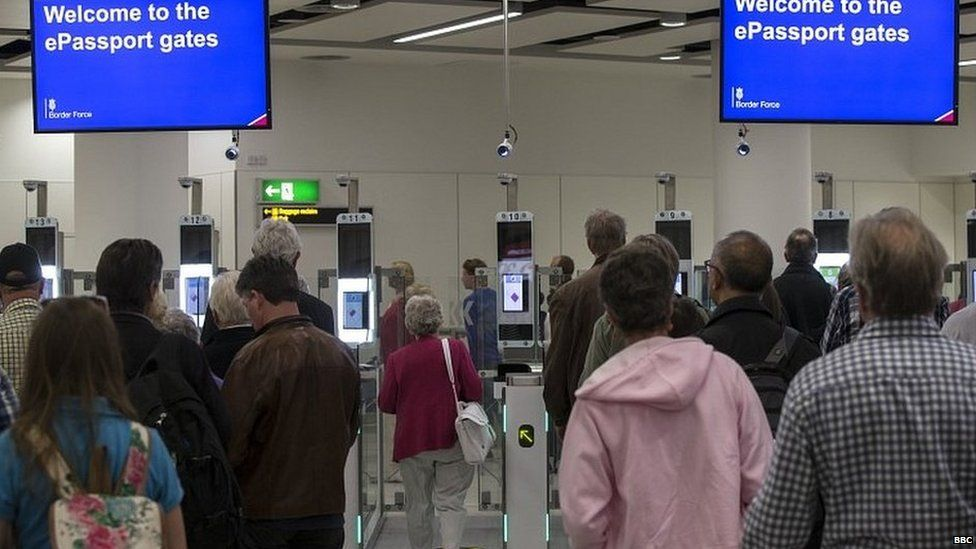 People waiting at passport control at Heathrow airport