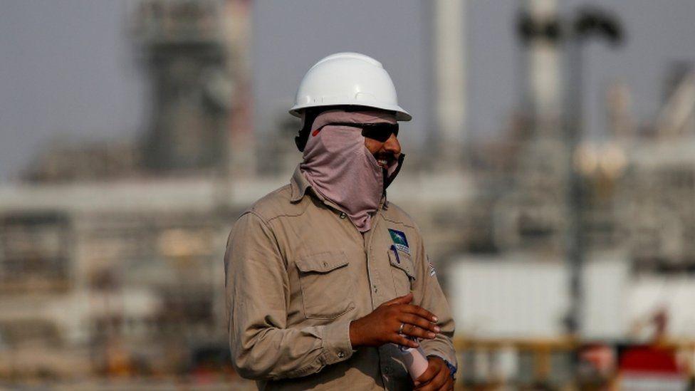 An employee looks on at Saudi Aramco oil facility in Abqaiq, Saudi Arabia.