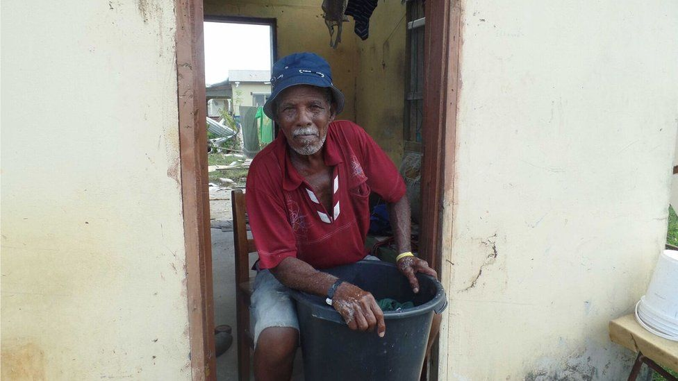 Manoah De Souza, 80, at work hand-washing his salvaged clothes