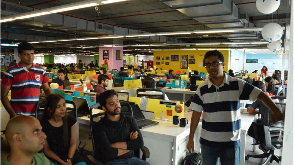 A meeting of young people in a colourful InMobi office