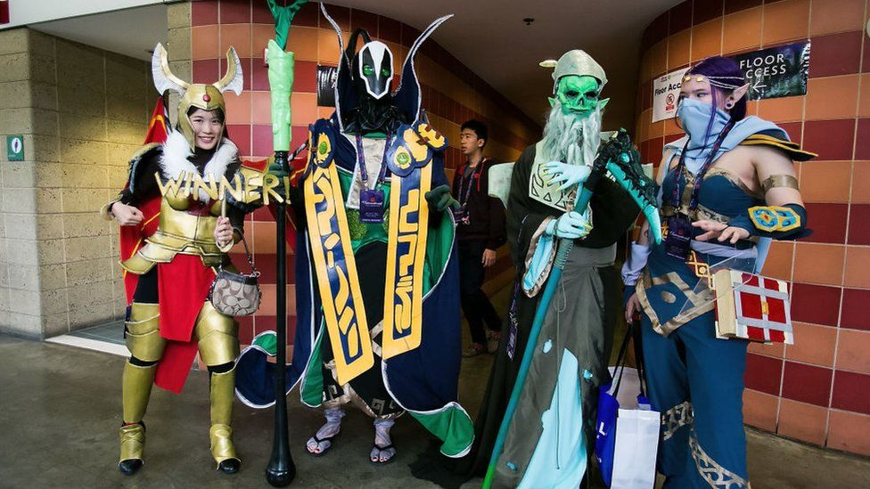 Fans dressed in cosplay pose for a photo at The International DOTA 2 Championships on July 20, 2014 in Seattle, Washington
