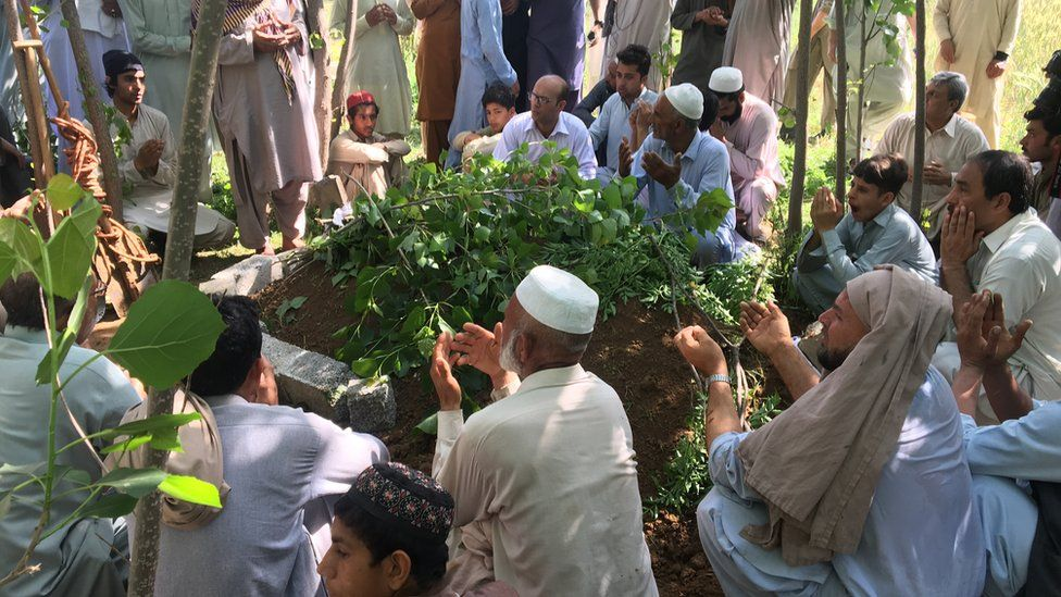 Mourners at Mashal Khan's grave