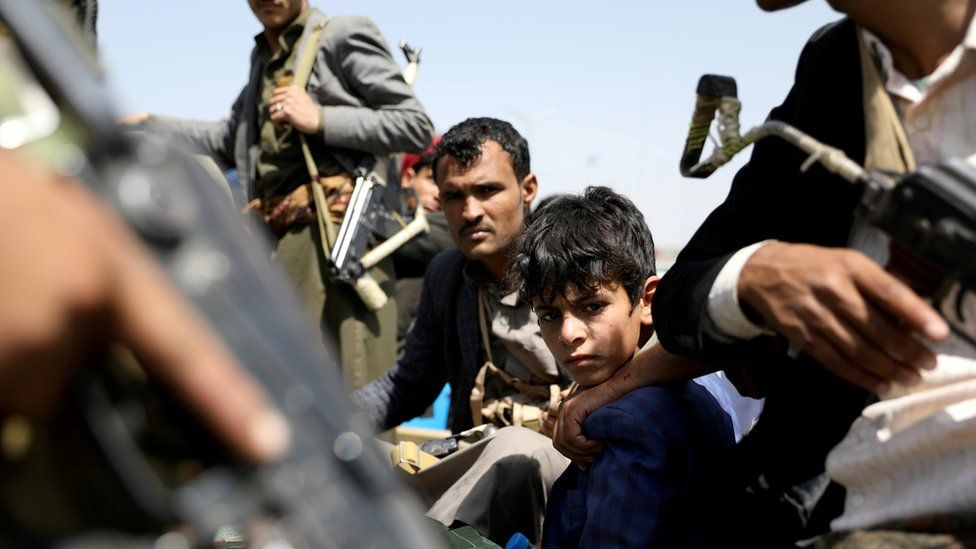 A boy rides with Houthi supporters in a vehicle during a funeral in Sanaa, Yemen (22 September 2020)