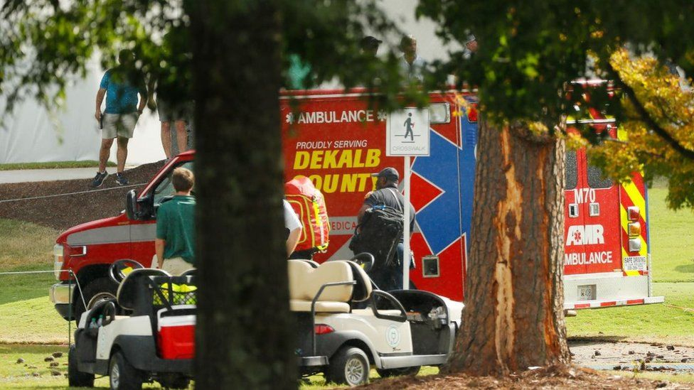 Emergency services provide assistance next to a tree damaged by a lightning strike at East Lake Golf Club on 2 August 2019 in Atlanta, Georgia