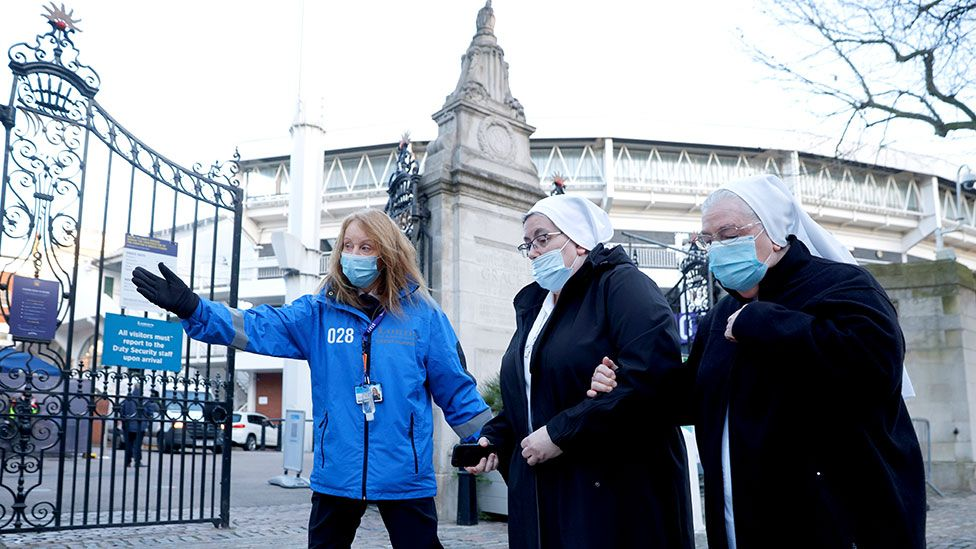 Nuns arrive at Lord's Cricket Ground in London to receive vaccine