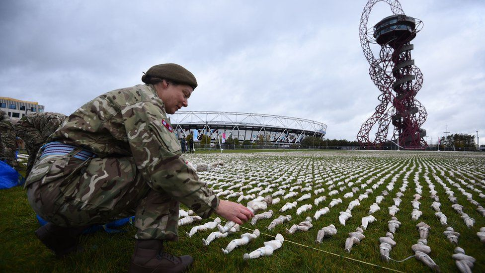 A soldier helps set out the Shrouds of the Somme