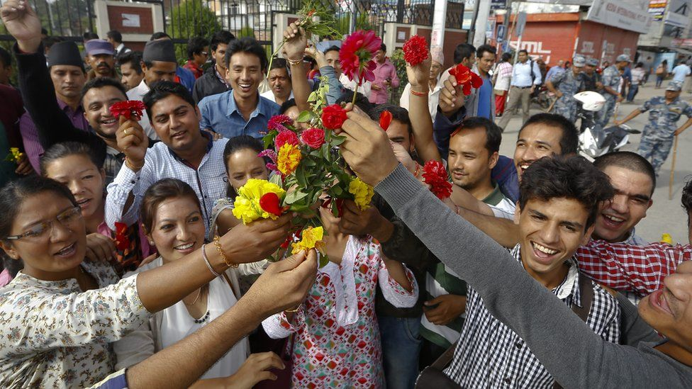 Nepalese youth cheers as they stage a flower rally to welcome the new constitution of Nepal in Kathmandu, Nepal, 17 September 2015