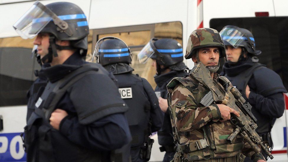 Police forces and soldiers patrol in Saint-Denis, a northern suburb of Paris