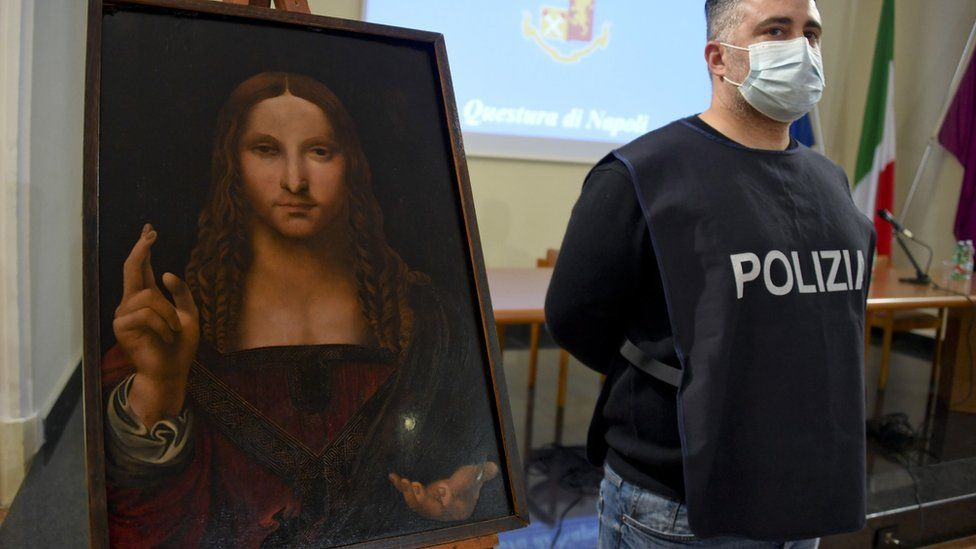 Image shows a police officer stood next to the recovered painting