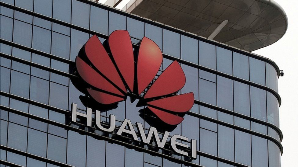 """The Huawei logo is pictured outside its Huawei""""s factory campus in Dongguan, Guangdong province, China March 25, 2019"""