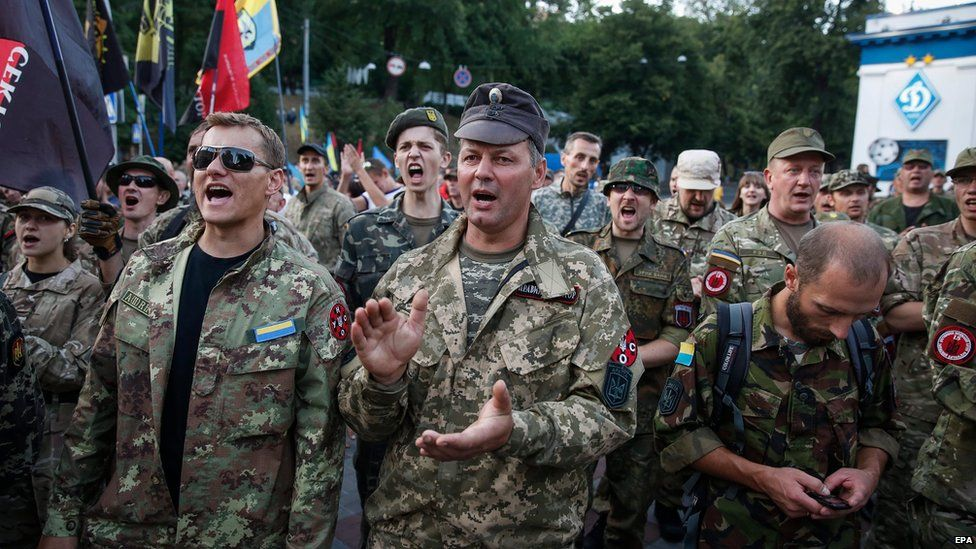 Members and supporters of Right Sector and other ultra-right political parties attend a protest on Grushevskogo street in Kiev, Ukraine, 3 July 2015