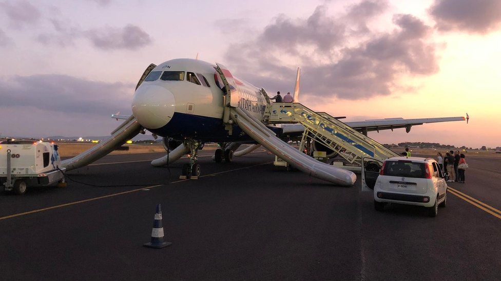 The plane pictured after landing on the runway in Valencia