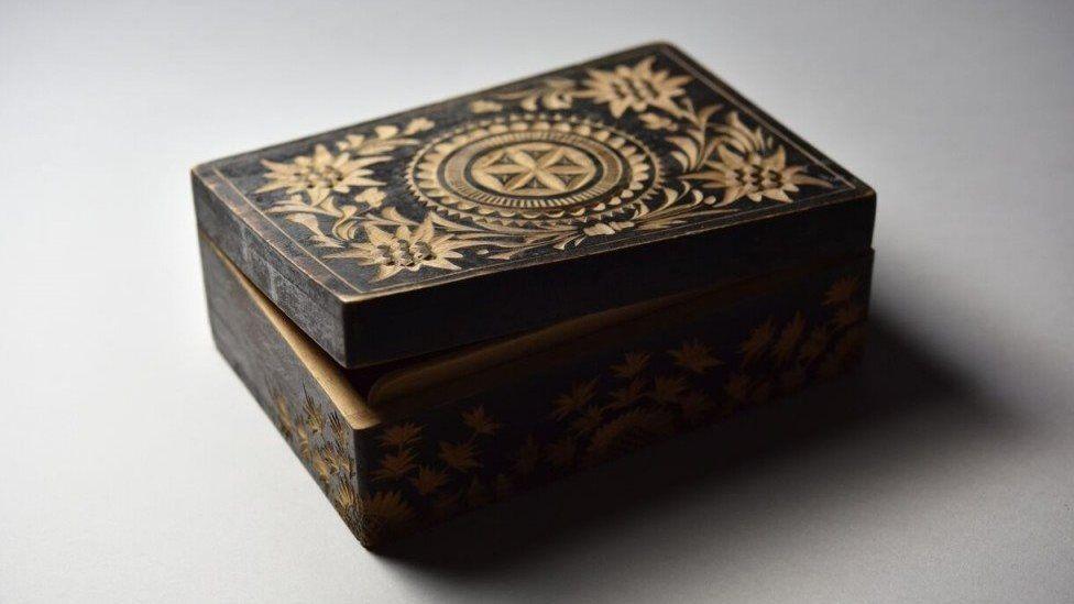 A wooden box made in Auschwitz by a prisoner Bronisław Czech