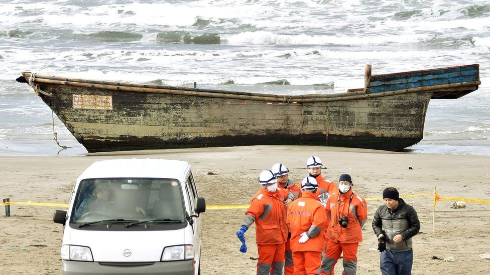 A wooden boat, which drifted ashore with eight partially skeletal bodies and was found by the Japan Coast Guard, is seen in Oga, Akita Prefecture, Japan, in this photo taken by Kyodo on 27 November 2017