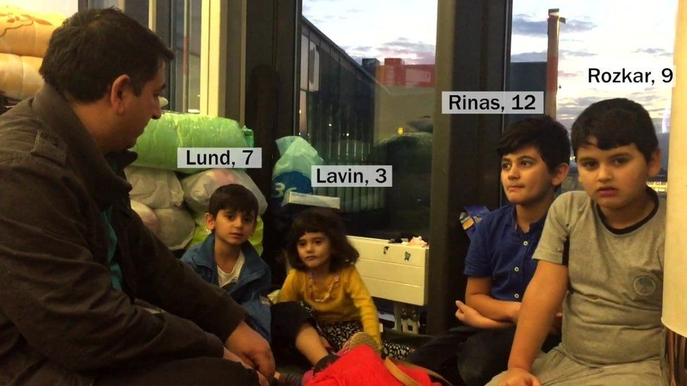 Hasan and his four children, Lund (7), Lavin (3), Rinas (12) and Rozkar (9).
