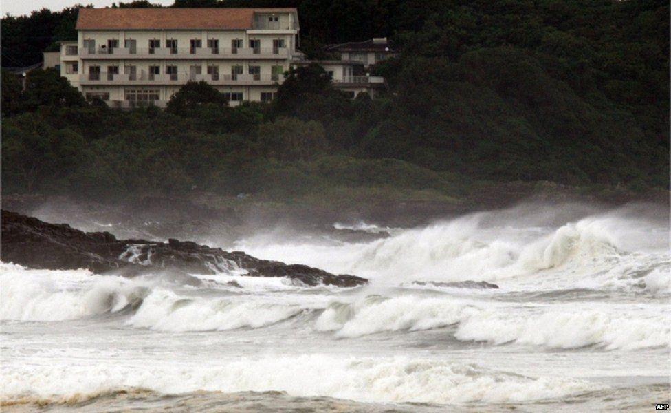 "High waves crash into the coast at Hyuga in Miyazaki prefecture, Japan""s southern island of Kyushu on 16 July 2015."